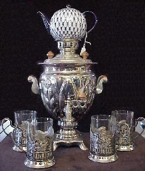 Silver Samovar with silver and glass tea cups