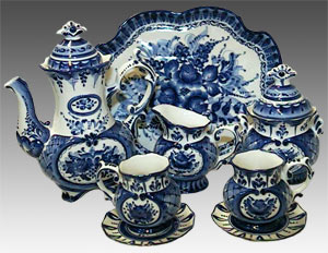 A Russian painted Gzhel teaset consisting of a teapot, teacups, saucers and a serving tray