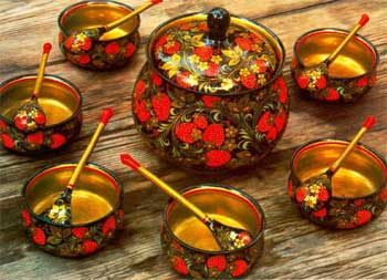 Russian Decorated Timber (Khokhloma) set consisting of bowls, spoons and a pot