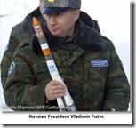 Vladimir Putin holding model rocket